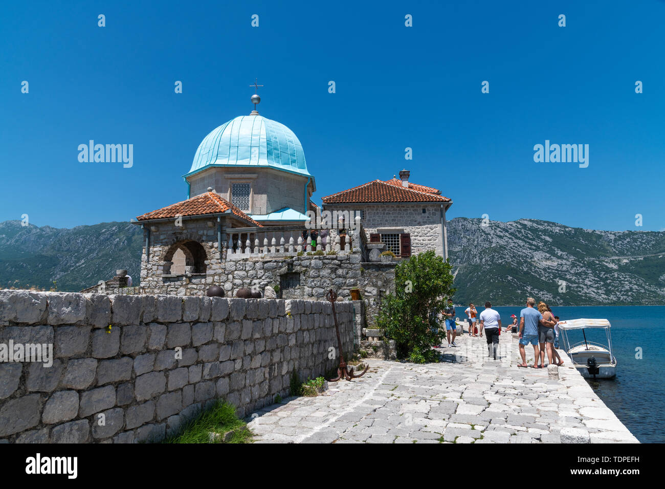 Perast, Montenegro - June 10. 2019: Church of Our Lady of Rocks on island of Gospa od Skrpjela. - Stock Image