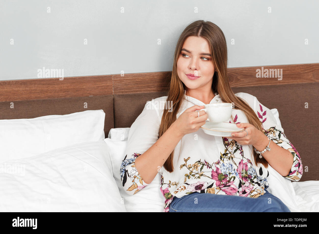 Morning coffee or tea in bed - Stock Image