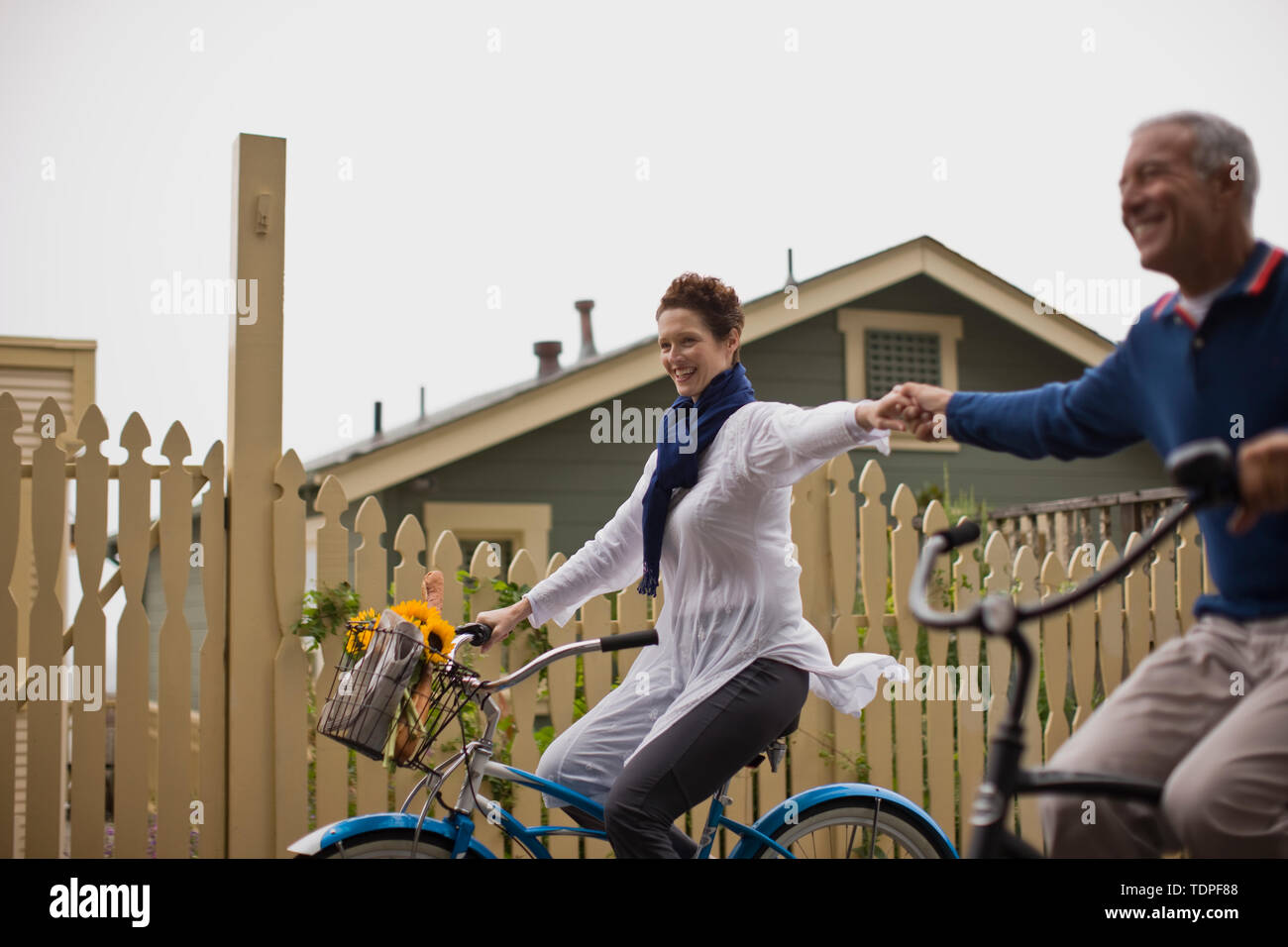 Couple riding bikes together - Stock Image