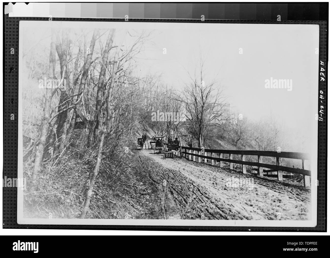 (from collection of Mrs. L. J. Fargo, Lexington, Ohio) showing HORSE DRAWN VEHICLES MEETING ON SIDEHILL TRAIL ON FULLERS HILL, 1890. - Forty-sixth Street Bridge, Spanning Ashtabula River, Ashtabula, Ashtabula County, OH - Stock Image