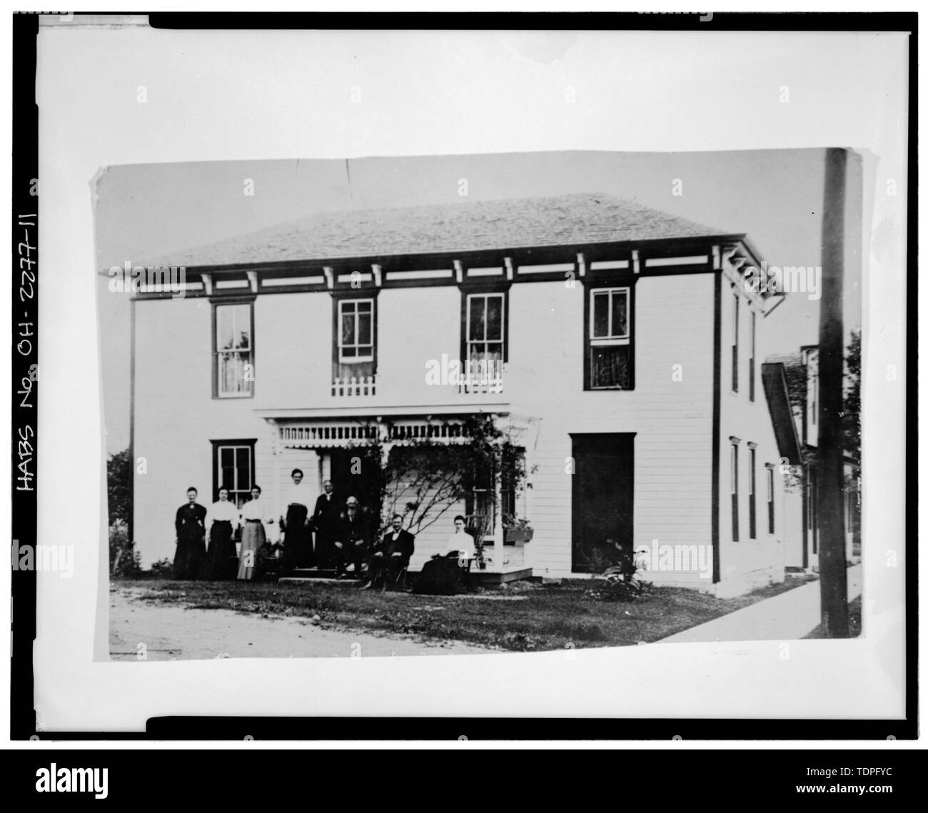 (original photograph property of Carolyn Blankenship, Covington, Miami County, Ohio), photographer and date unknown, circa- 1900. VIEW SOUTHEAST, NORTH FRONT AND WEST SIDE, SHOWS STEINHILBER FAMILY - Martin Steinhilber House, 402 South High Street, Covington, Miami County, OH - Stock Image