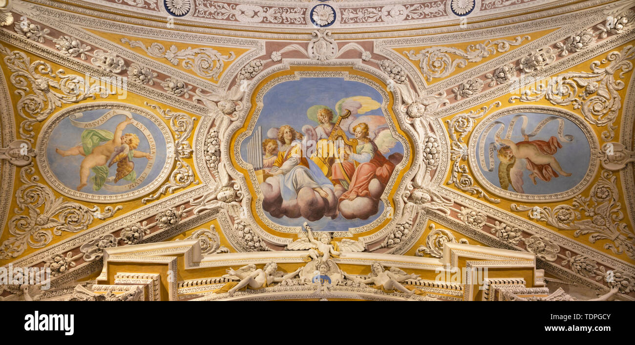 OSSUCCIO, ITALY - MAY 8, 2015: The baroque fresco choir of angels with the music instruments in church Sacro Monte della Beata Vergine del Soccorso. - Stock Image