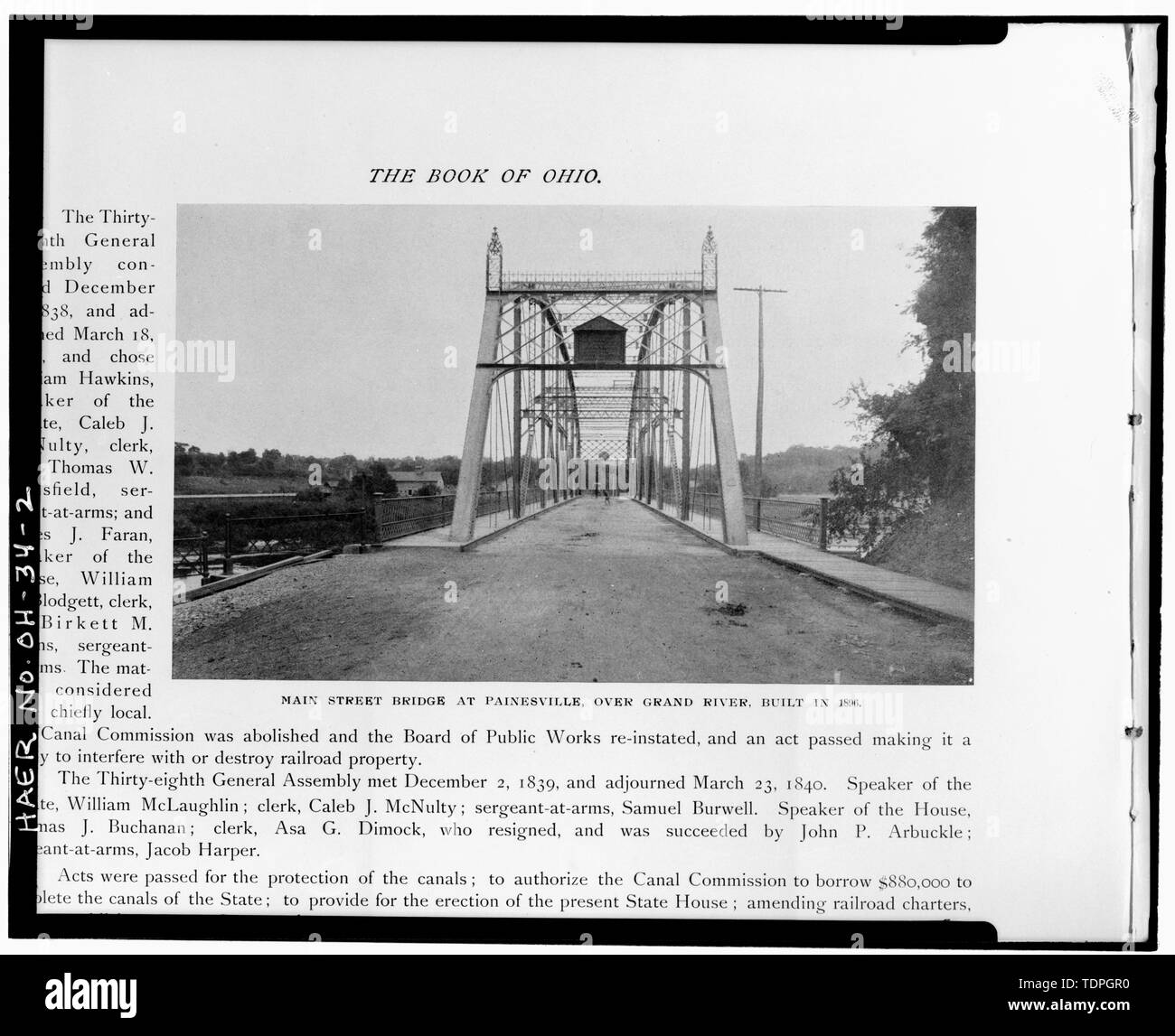 . VIEW EAST SHOWING WEST PORTAL WITH FINIALS AND NAMEPLATE (from C. S. Van Tassel's The Book of Ohio (Vol. 1), Toledo, Ohio, 1901 (p. 200.) - Main Street Bridge, Spanning Grand River at Main Street, Painesville, Lake County, OH - Stock Image