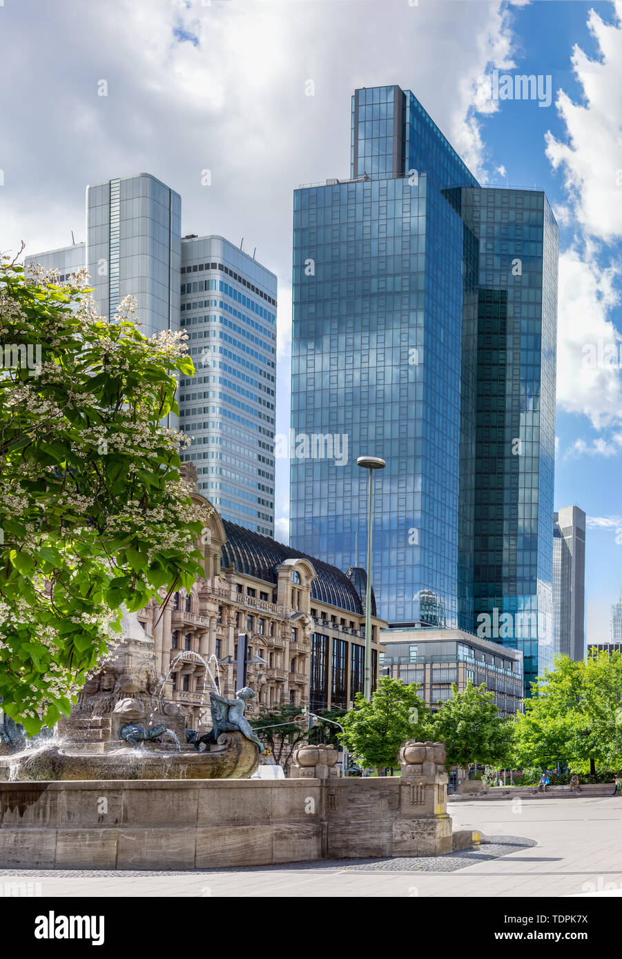 Skyscrapers behind a Fountain in a Urban Area of a Modern City - Stock Image