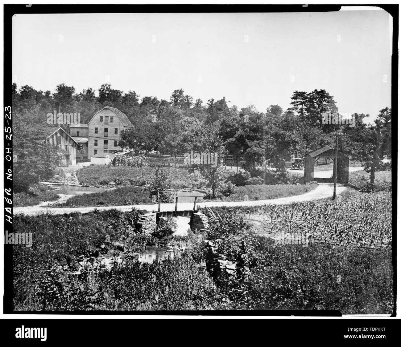 source and date unknown. VIEW FROM NORTHEAST SHOWING COVERED BRIDGE, BARN, MILL AND HOUSE - Mount Healthy Mill, Covered Bridge Road, Mount Healthy, Hamilton County, OH - Stock Image