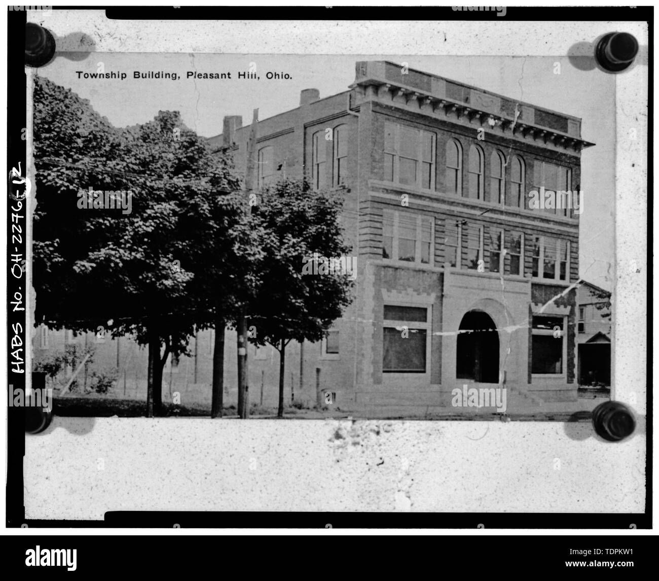 Photocopy of post card (original in possession of Village of Pleasant Hill), photographer and date unknown VIEW SOUTHEAST, WEST FRONT AND NORTH SIDE - Newton Township Building, South Main Street near Hill Street, Pleasant Hill, Miami County, OH - Stock Image
