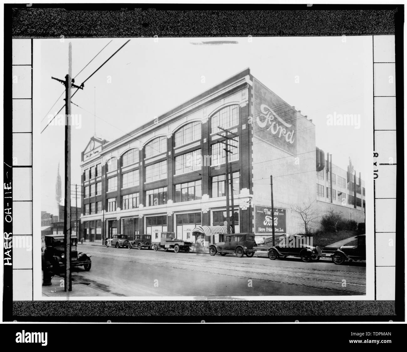 Photocpy of early 20th century photograph, looking east, of east facade of assembly building on Euclid Ave. Photo owned by the Cleveland Public Library. - Ford Motor Company, Cleveland Branch Assembly Plant, Euclid Avenue and East 116th Street, Cleveland, Cuyahoga County, OH - Stock Image