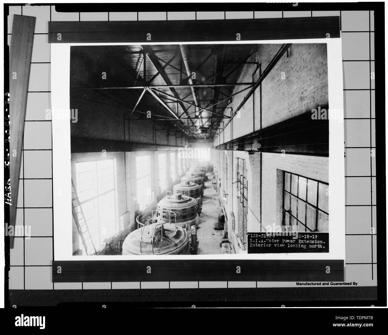 Photograph of a photograph in possession of Rock Island Arsenal Historical Office. VERTICAL WESTINGHOUSE GENERATORS IN 1919 ADDITION. DATED FEBRUARY 19, 1919. - Rock Island Arsenal, Building No. 160, Sylvan Drive, Rock Island, Rock Island County, IL; Central Engineering Company of Davenport - Stock Image