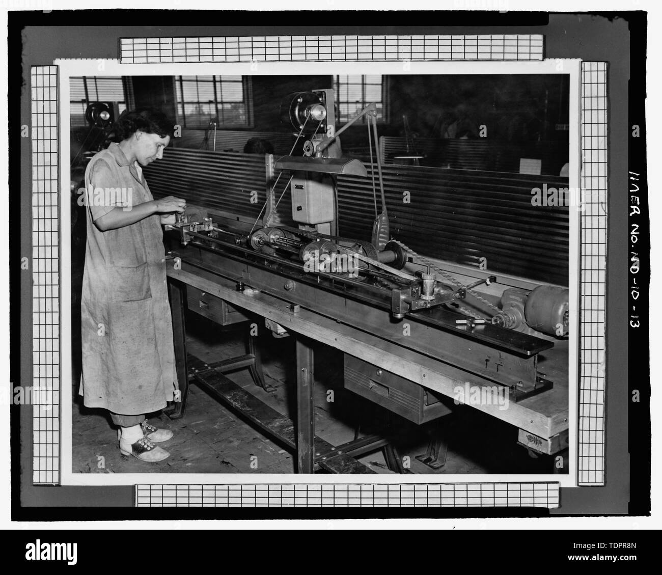 Photographic copy of photograph (original print in possession of William Langer Jewel Bearing Plant, Rolla, North Dakota). LARGE HOLE-OPENING - Turtle Mountain Ordnance Plant, 213 First Street Northwest, Rolla, Rolette County, ND - Stock Image