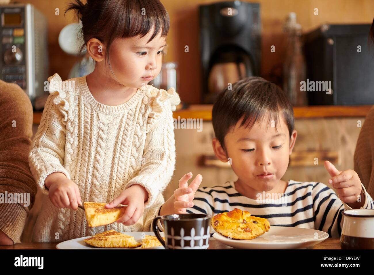 Japanese kids at home - Stock Image