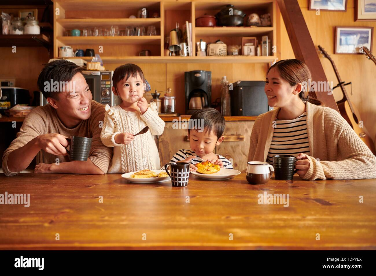 Japanese family at home - Stock Image
