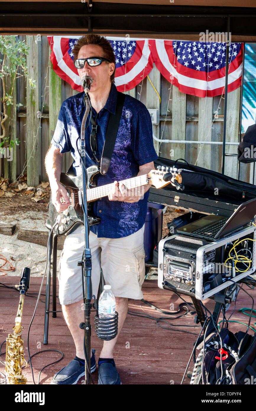 Captiva Island Florida The Mucky Duck restaurant outdoor bar man musician playing guitar singing entertainer Stock Photo