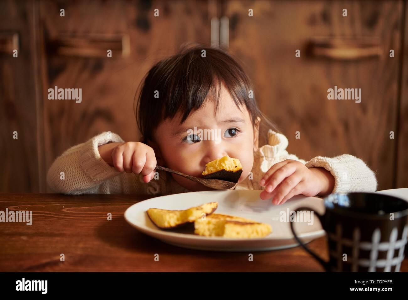 Japanese kid at home - Stock Image