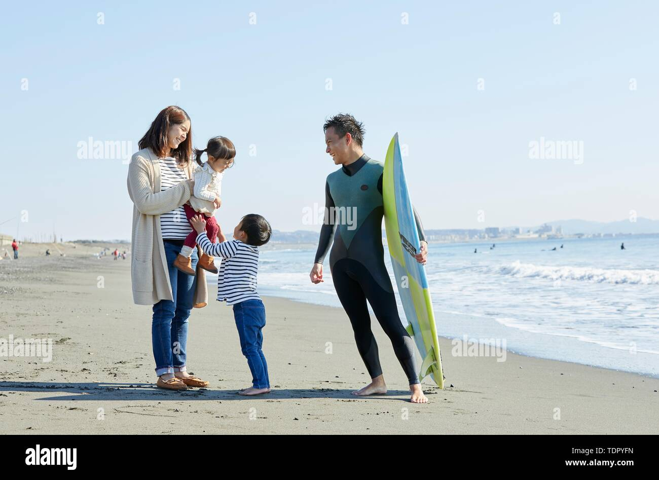 Japanese family at the beach - Stock Image