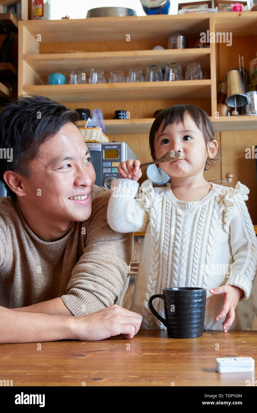 Japanese kid with father at home - Stock Image