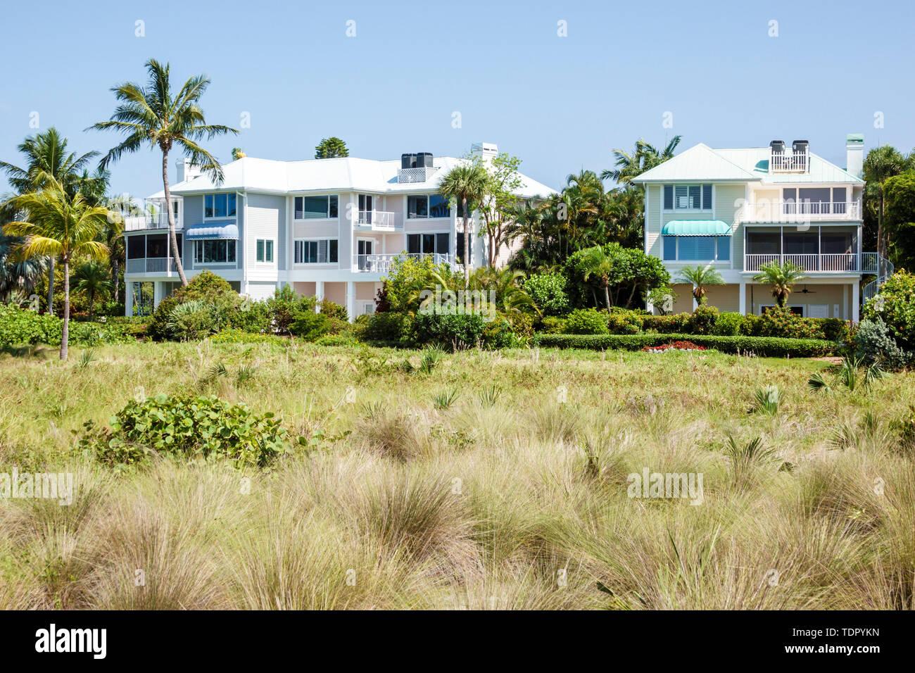 Sanibel Island Florida East Gulf Drive oceanfront beachfront homes large single-family houses multi-story dune grasses - Stock Image