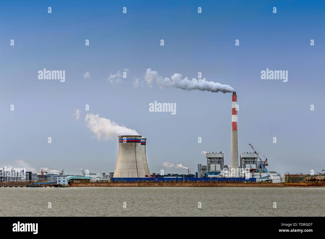 power station at riverbank - Stock Image