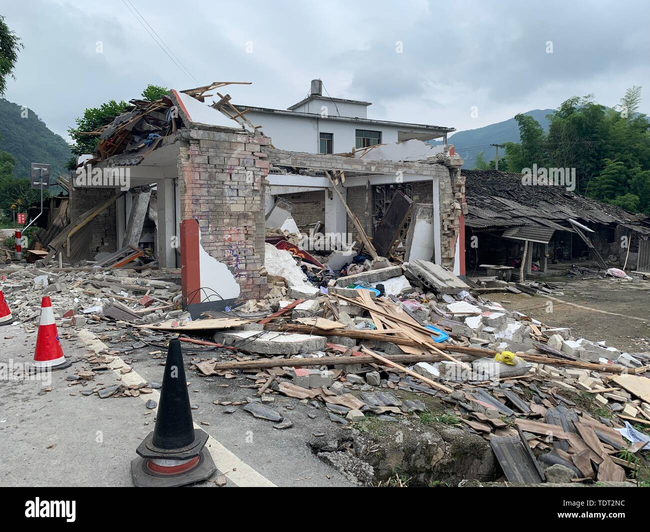 Changning. 18th June, 2019. Photo taken on June 18, 2019 shows collapsed houses at Putao Village in Shuanghe Town, Changning County of Yibin City, southwest China's Sichuan Province. Twelve people died and another 125 were injured after a 6.0-magnitude earthquake hit Changning County Monday night, China's Ministry of Emergency Management said on Tuesday. Credit: Chen Di/Xinhua/Alamy Live News - Stock Image