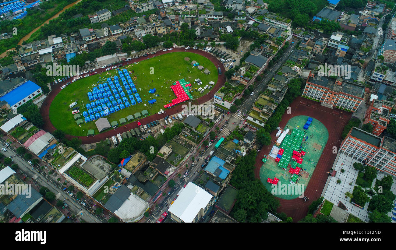 Changning. 18th June, 2019. Aerial photo taken on June 18, 2019 shows a temporary shelter at Shuanghe Town High School in Changning County of Yibin City, southwest China's Sichuan Province. Twelve people died and another 125 were injured after a 6.0-magnitude earthquake hit Changning County Monday night, China's Ministry of Emergency Management said on Tuesday. Credit: Liu Changsong/Xinhua/Alamy Live News - Stock Image