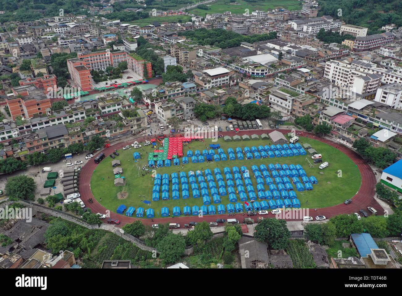 Changning. 18th June, 2019. Aerial photo taken on June 18, 2019 shows tents at a temporary shelter of Shuanghe Town High School in Changning County of Yibin City, southwest China's Sichuan Province. Thirteen people died and 199 were injured after a 6.0-magnitude earthquake hit southwest China's Sichuan Province at 10:55 p.m. Monday, the Ministry of Emergency Management said Tuesday. Credit: Zeng Lang/Xinhua/Alamy Live News - Stock Image
