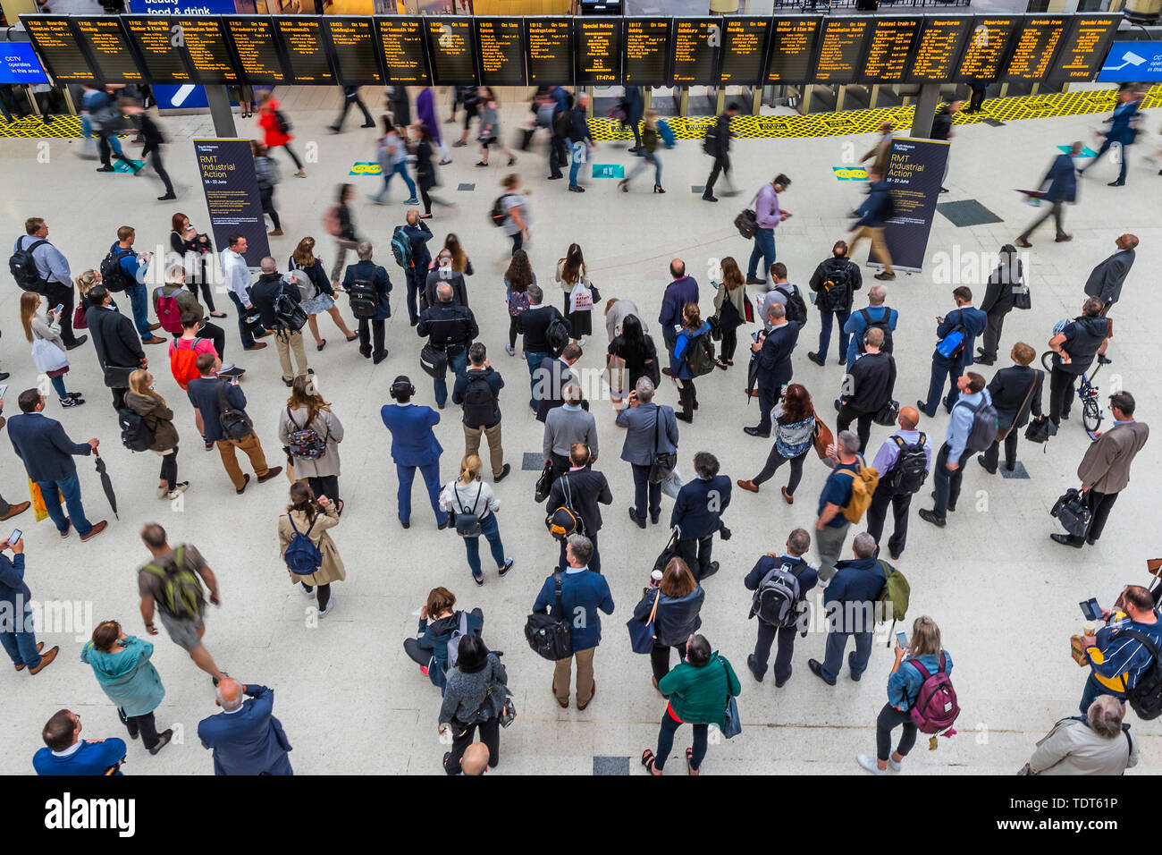 London, UK. 18th June, 2019. Crowds build up due to a reduced service because of the strike by RMT staff on SW Trains,  but are not as heavy as expected. Passengers wait for news of their trains on the concourse of Waterloo Station, London. Credit: Guy Bell/Alamy Live News - Stock Image