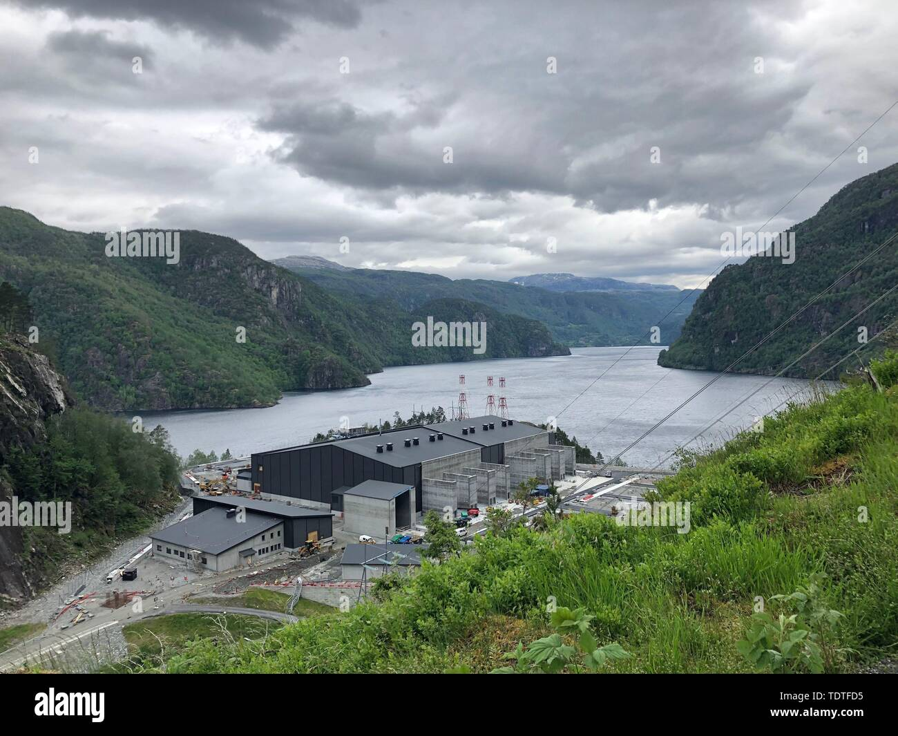 """A converter power station is being built to help transmit electricity from Norway's hydropower to the British grid, as water flowing from mountains to fjords in Norway will soon be helping power British homes, as the world's longest """"interconnector"""" hooks up the two countries' grids. - Stock Image"""