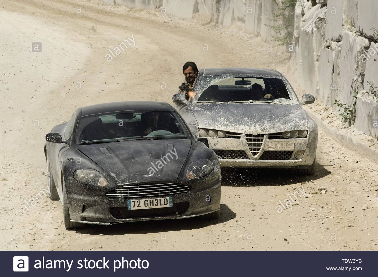 Undated handout file photo issued by United Artists Corporation of a car chase scene in Quantum of Solace featuring the 2008 Aston Martin 6 Litre V12 DBS 2-Door Coupe used by Daniel Craig. The deliberate destruction of James Bond's pristine Aston Martin was 'too much' for stunt driver Ben Collins to watch. - Stock Image