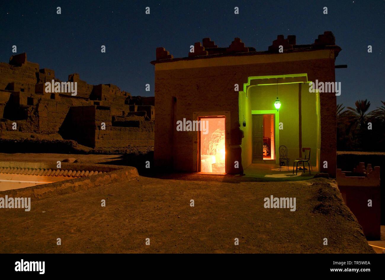 illuminated room at berber mud castle Cais Ali, Morocco, Agdz Kasbah Stock Photo