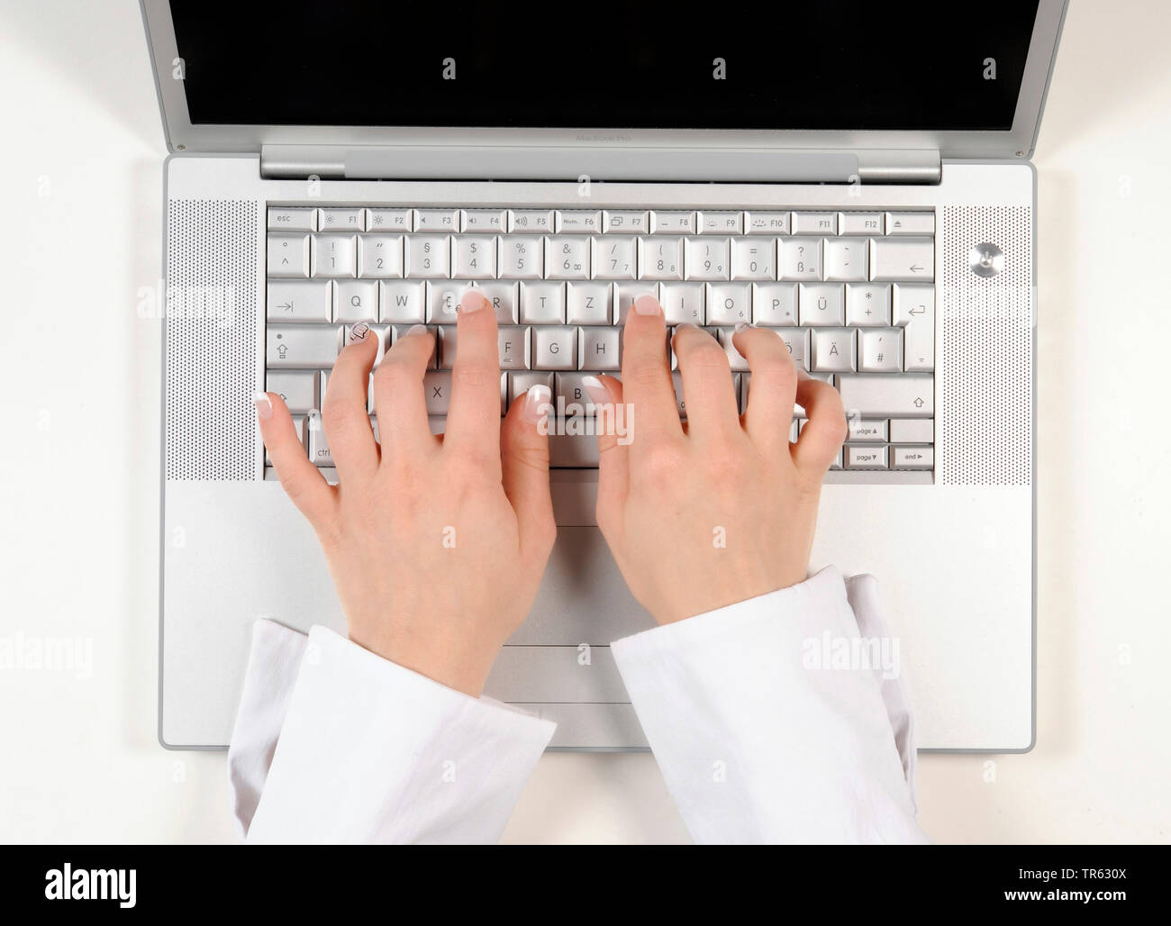 woman's hands writing on a laptop, Germany - Stock Image