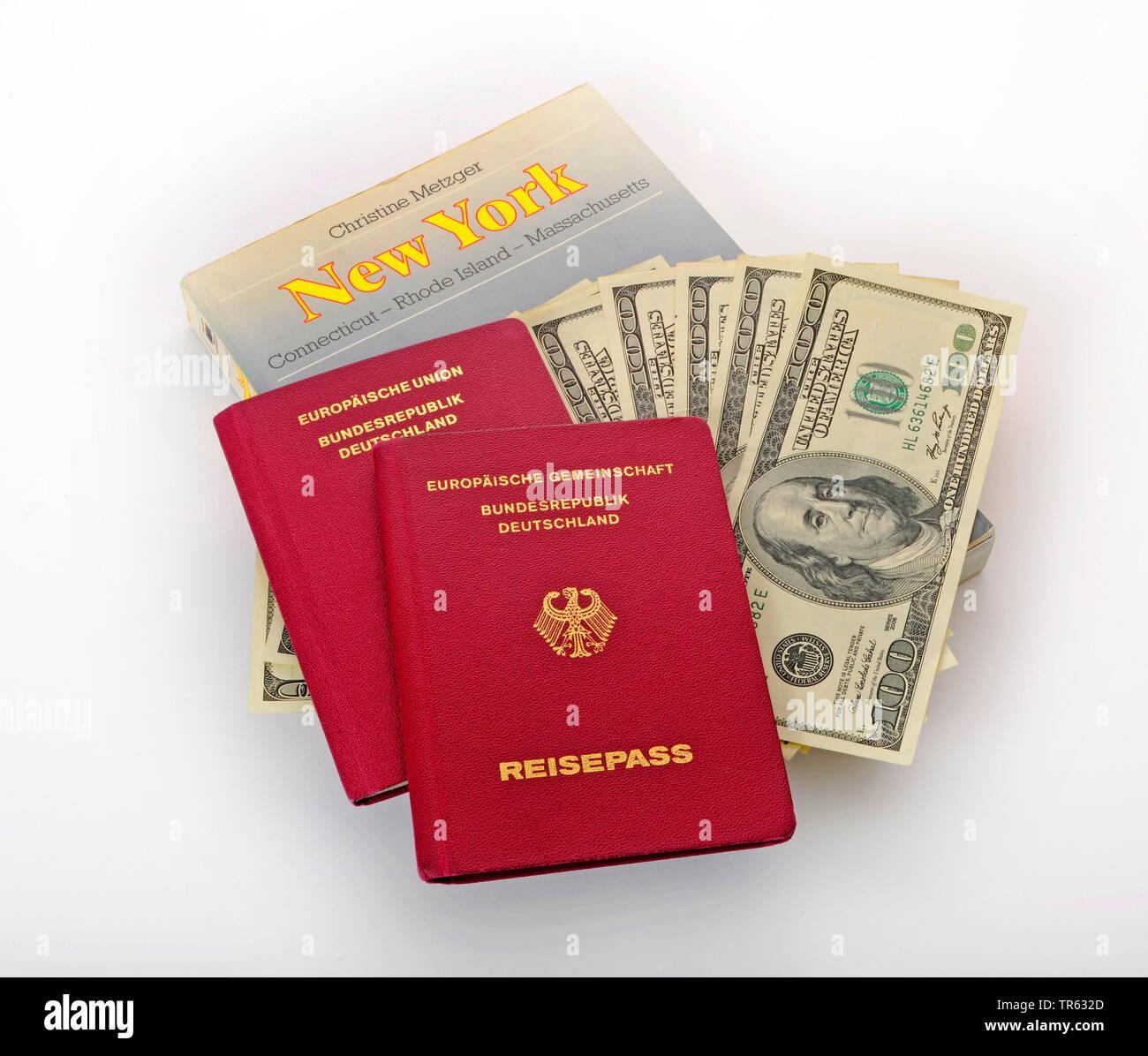 Reisepaesse und Reisefuehrer fuer die USA mit Dollarnoten, Deutschland | identity cards and guidebooks with dollar bills, Germany | BLWS472091.jpg [ ( - Stock Image