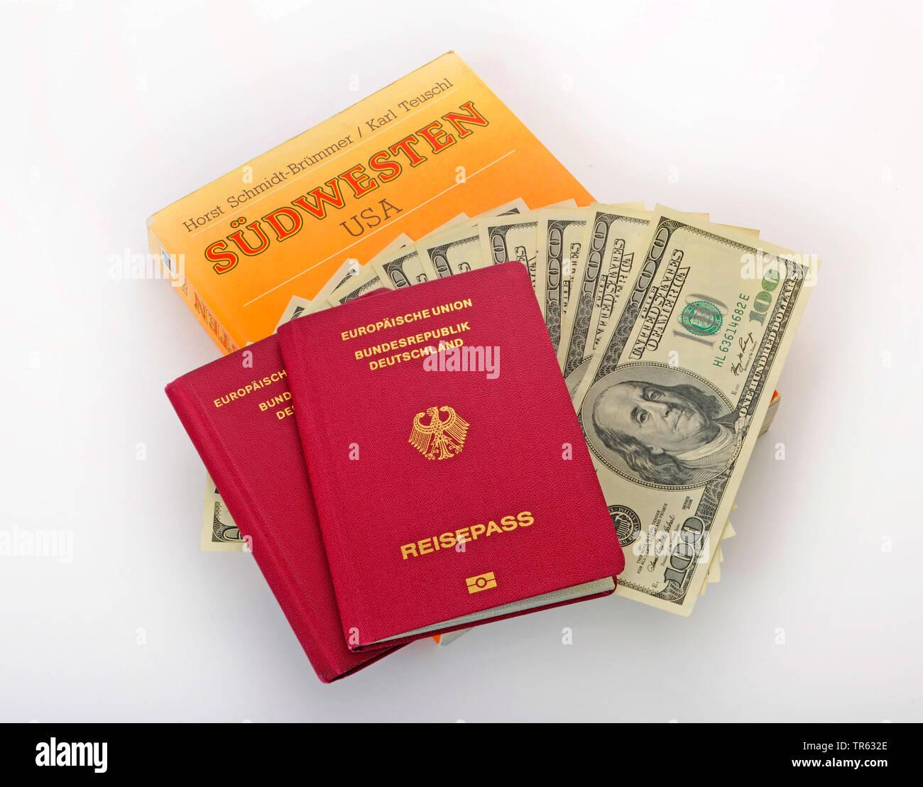 Reisepaesse und Reisefuehrer fuer die USA mit Dollarnoten, Deutschland | identity cards and guidebooks with dollar bills, Germany | BLWS472092.jpg [ ( - Stock Image