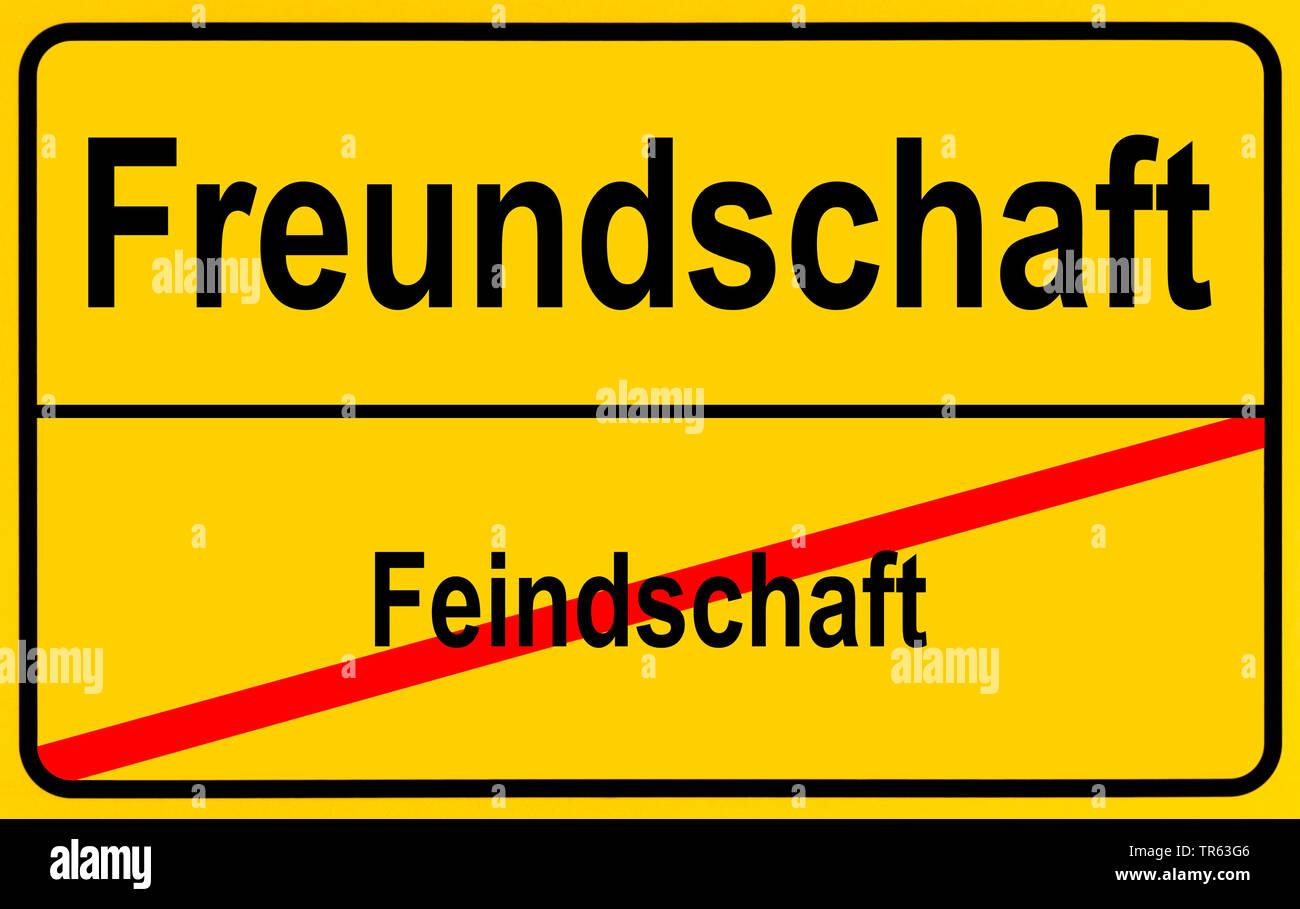 city limit sign Freundschaft / Feindschaft, friendship / enmities, Germany - Stock Image