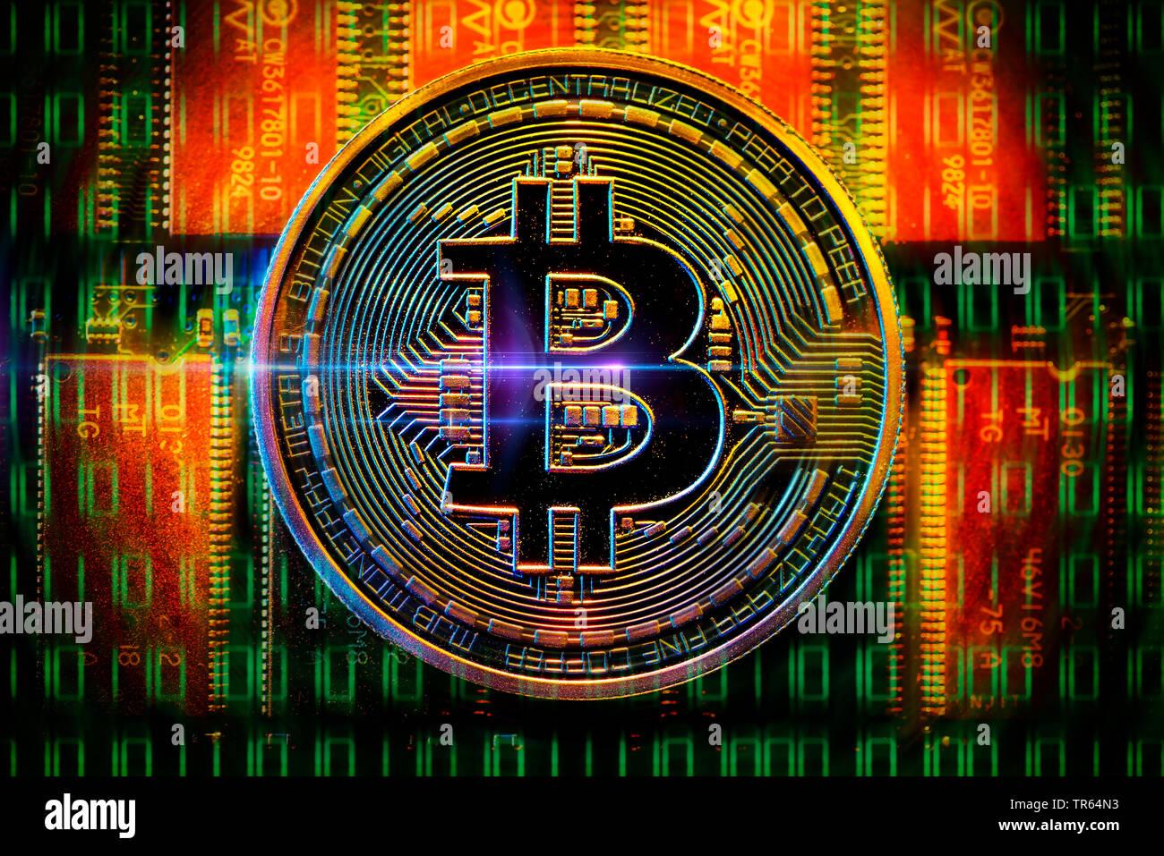 Muenze mit Bitcoin-Zeichen und Platine   Bitcoin with board   BLWS473515.jpg [ (c) blickwinkel/McPHOTO/C. Ohde Tel. +49 (0)2302-2793220, E-mail: info@ - Stock Image