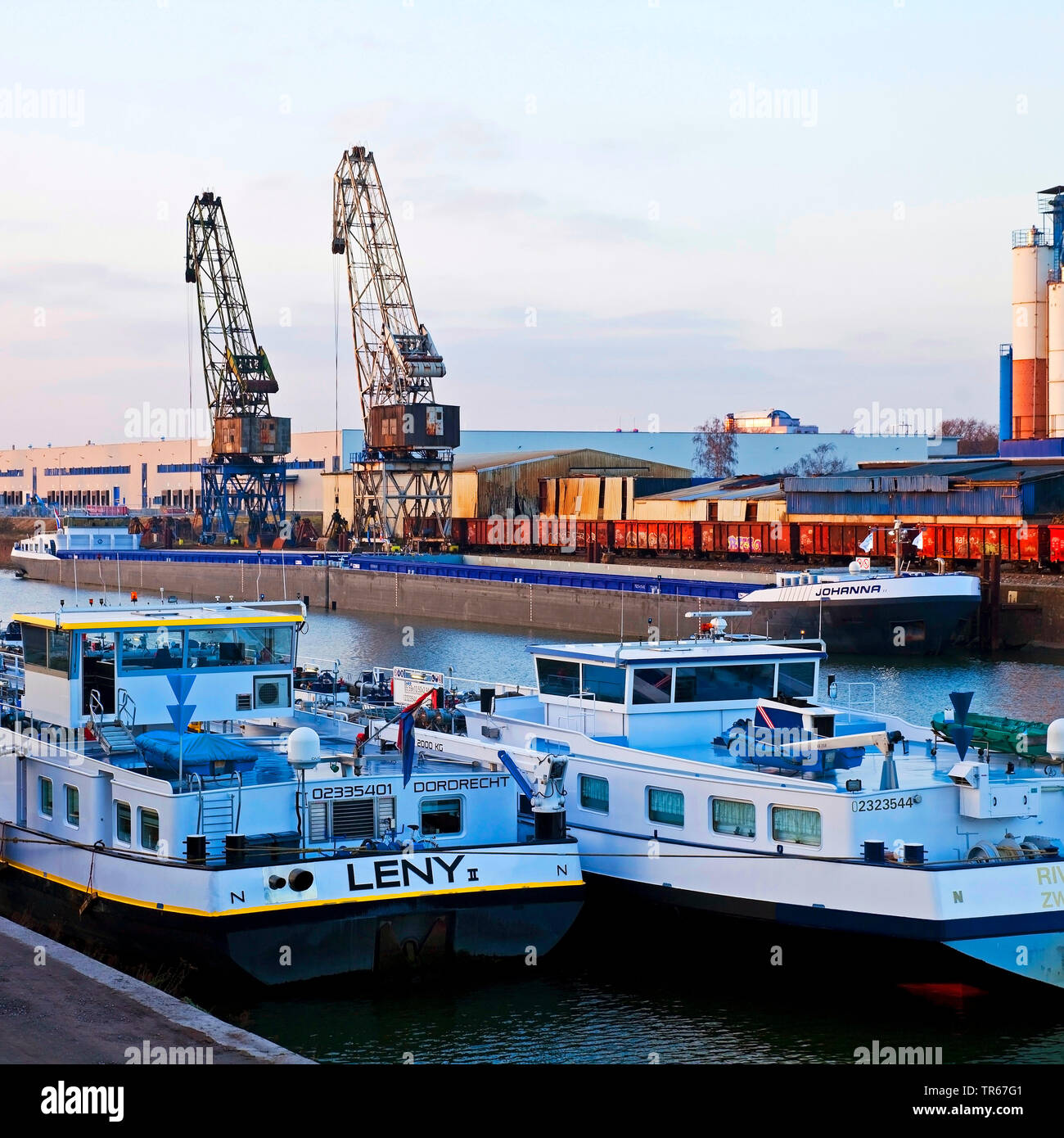 freight ships and cranes in inland port Duisburg, Germany, North Rhine-Westphalia, Ruhr Area, Duisburg Stock Photo