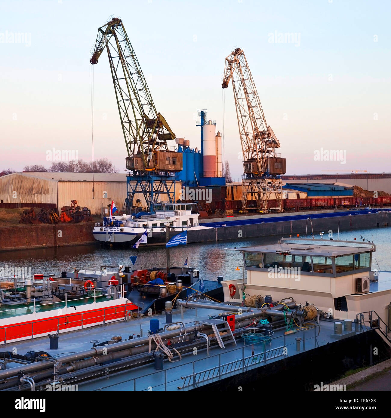 freight ships and cranes in inland port Duisburg, Germany, North Rhine-Westphalia, Ruhr Area, Duisburg - Stock Image