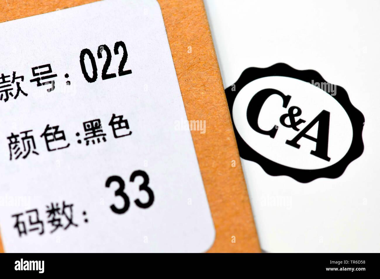 C & A Logo und chinesisches Etikett, Traditionsunternehmen C&A prueft den Verkauf des Unternehmens nach China, Deutschland | C & A checking the sale t - Stock Image