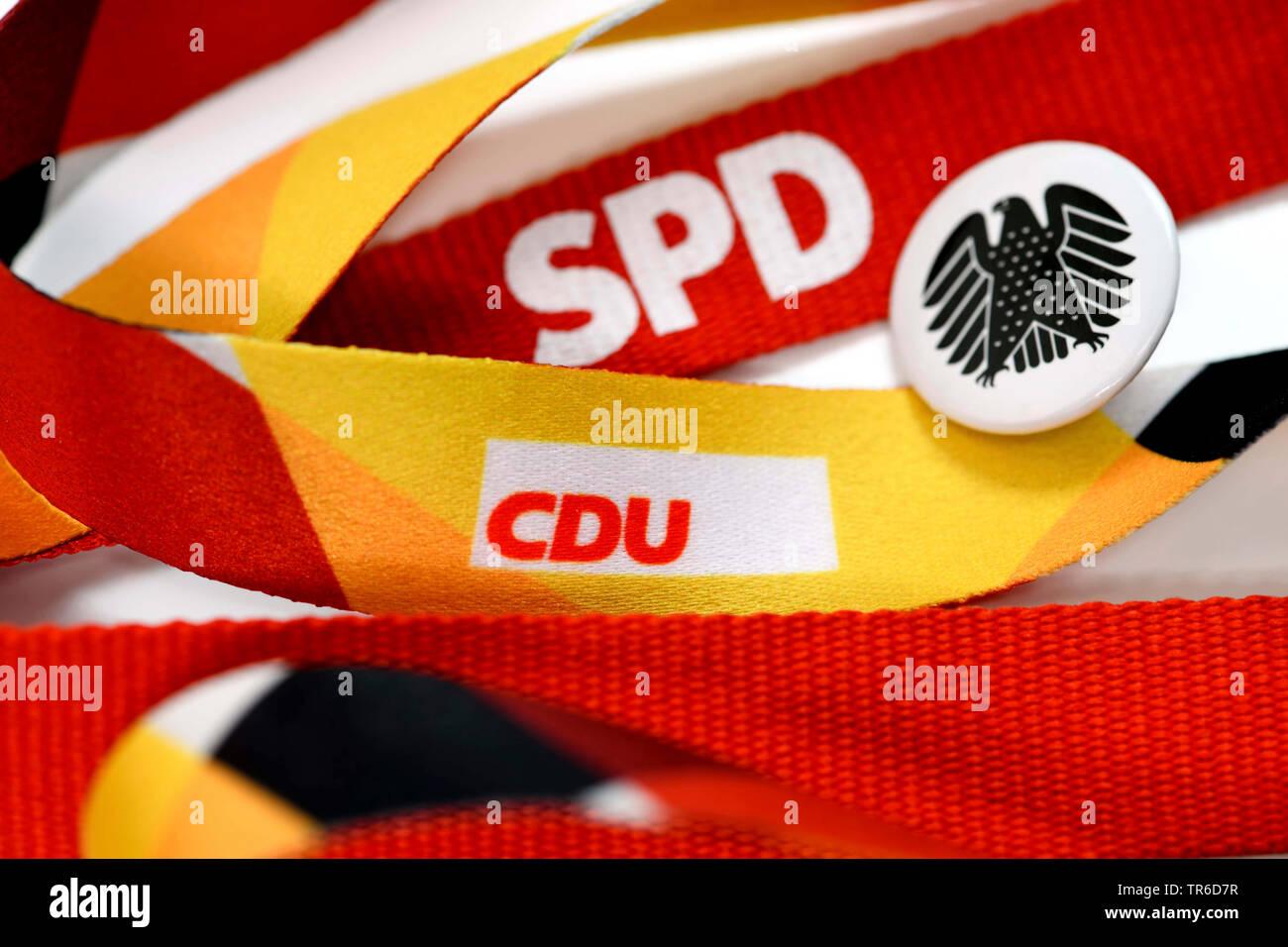 Schluesselbaender  mit den Logos von CDU und SPD mit Bundesadler, Symbolfoto fuer die Grosse Koalition, Deutschland | lanyards with the logos of the p - Stock Image