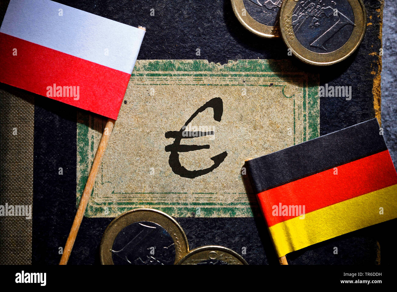 flags of Germany and Poland, book with the word reparation claim, Germany - Stock Image
