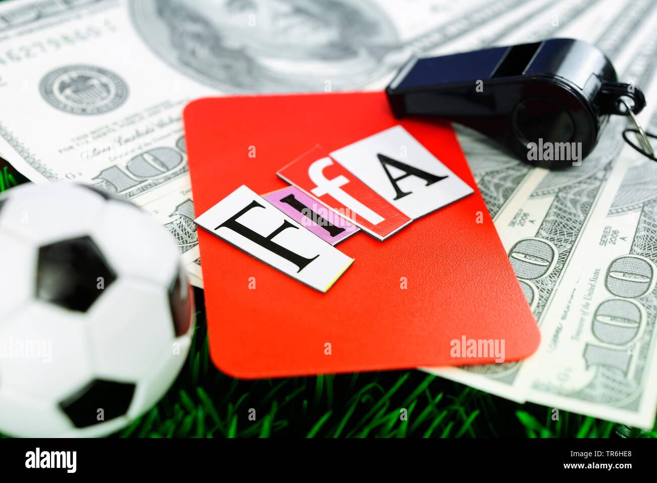 Miniaturfussball mit roter Karte, Dollarscheinen und Pfeife, Fifa-Skandal | red card and football, dollar bills and whistle, FIFA scandal  | BLWS48452 - Stock Image