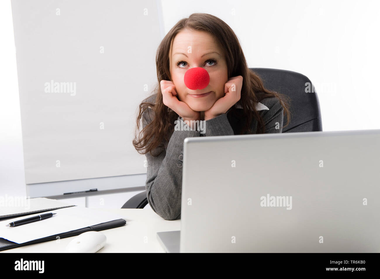 Geschaeftsfrau mit roter Clownnase | business woman with red nose | BLWS486078.jpg [ (c) blickwinkel/McPHOTO/M. Begsteiger Tel. +49 (0)2302-2793220, E - Stock Image