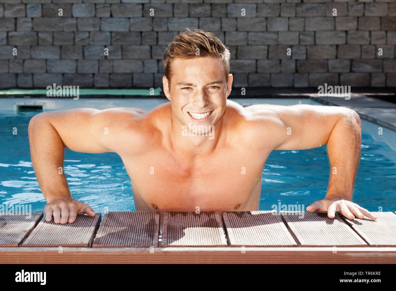 junger Mann verlaesst den Swimmingpool, Deutschland | young man leaving pool, Germany | BLWS486440.jpg [ (c) blickwinkel/McPHOTO/M. Gann Tel. +49 (0)2 - Stock Image