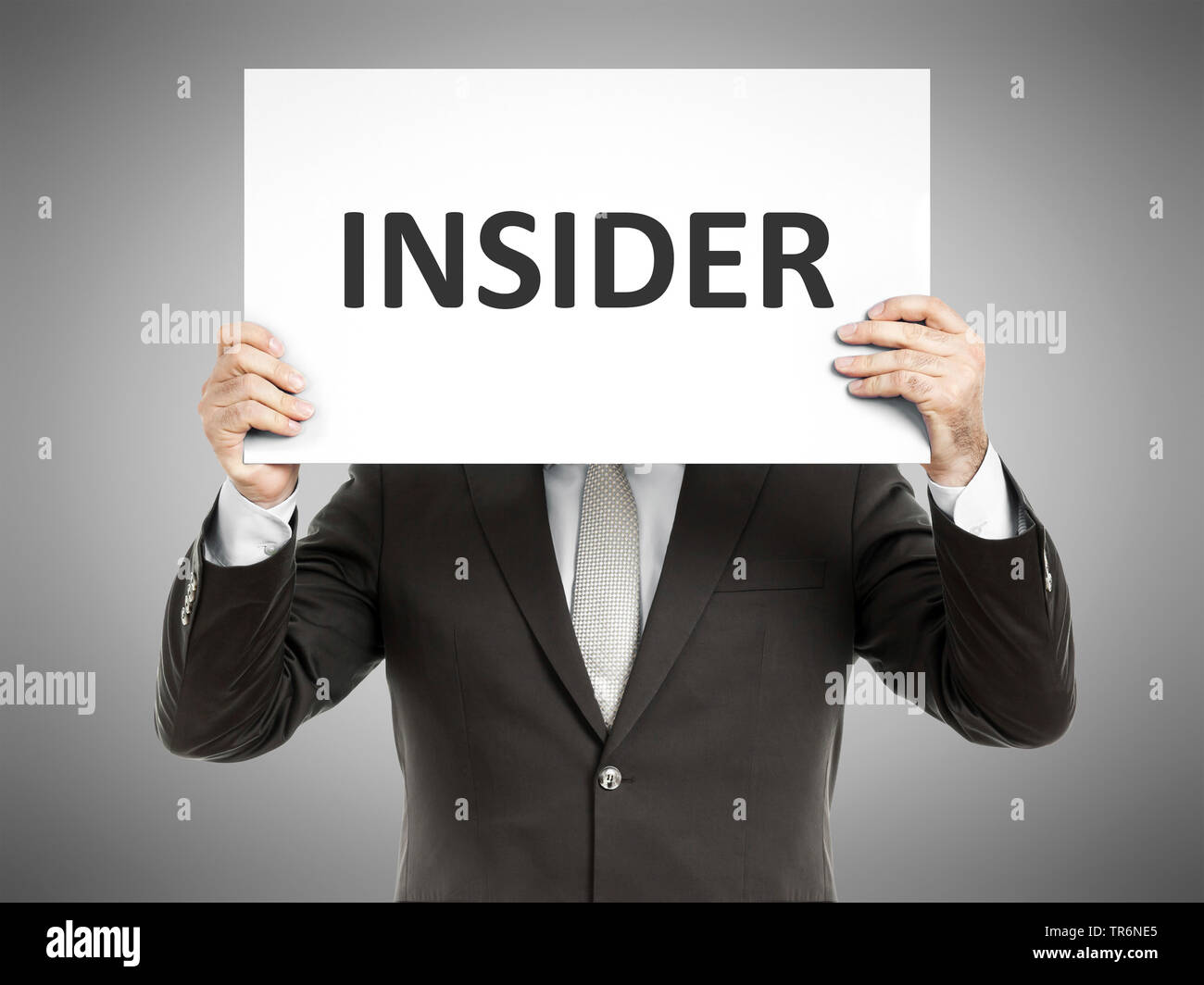 businessman holding a sign with the inscription Insider, Germany Stock Photo