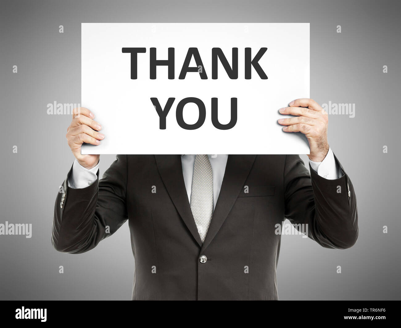 businessman holding a sign with the inscription Thank You, Germany Stock Photo