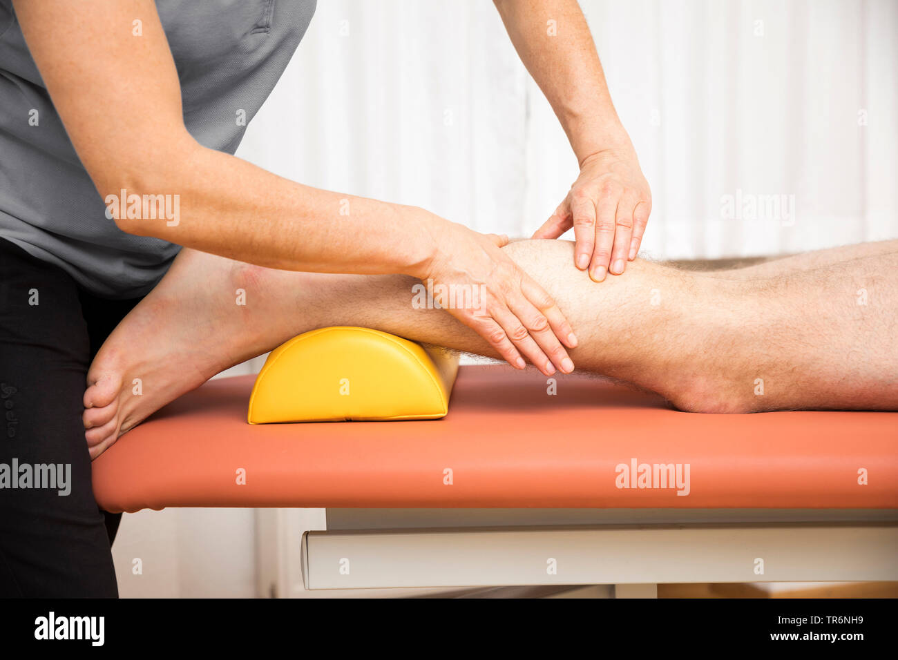 young man at the physio therapy, Germany - Stock Image