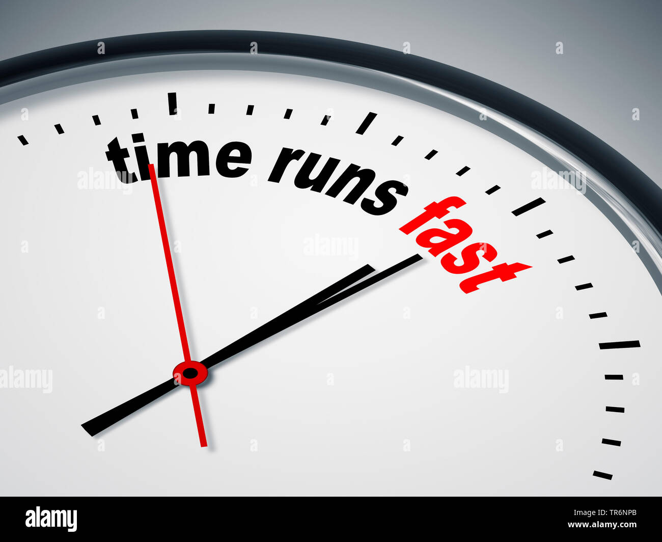 clock face with inscription time runs fast - Stock Image