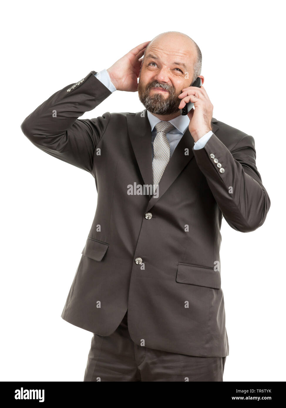 Middle-aged businessmann calling with his phone near his ear, Germany Stock Photo