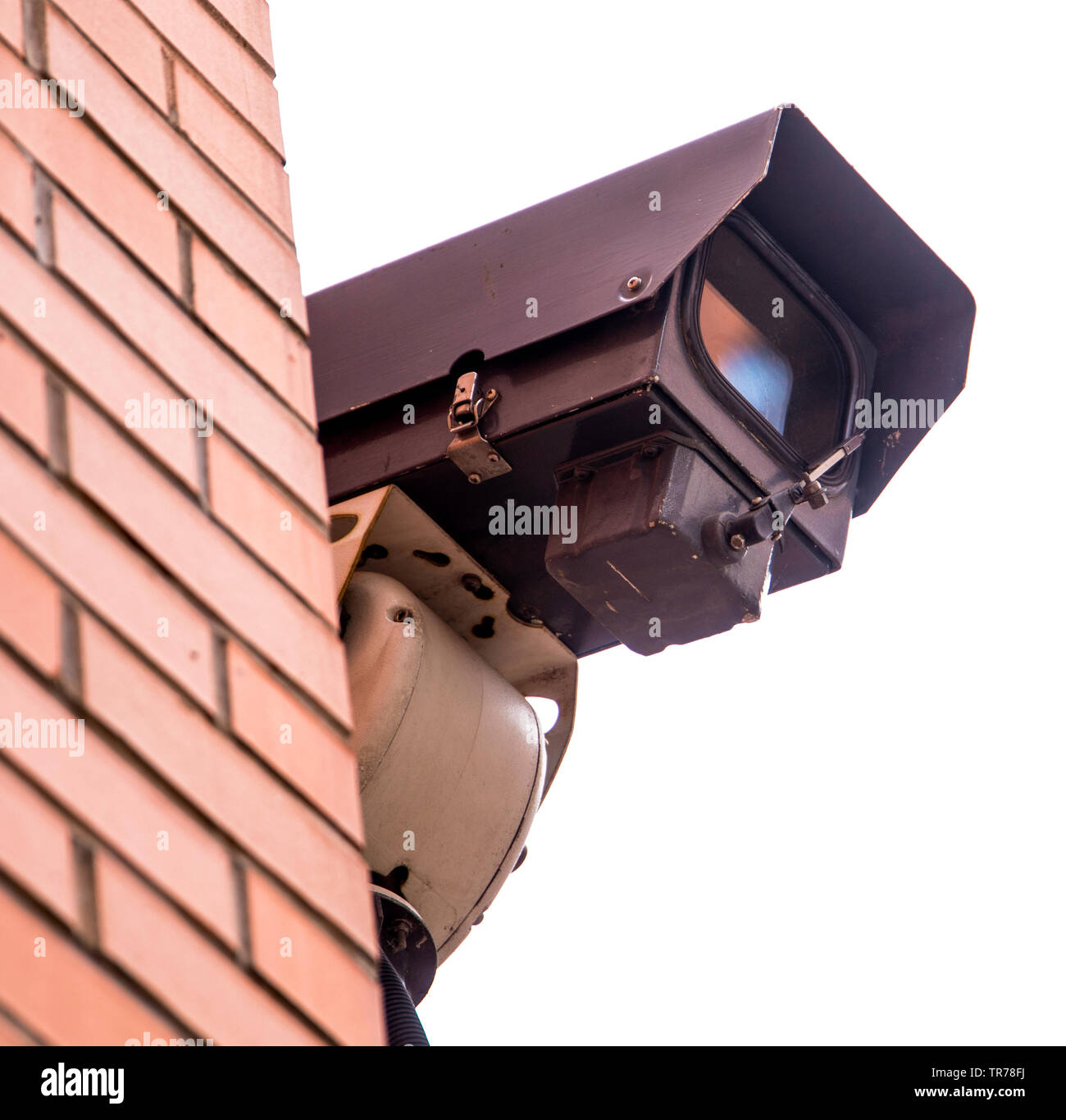 You are being watched closely by a wall mounted CCTV Camera - Stock Image