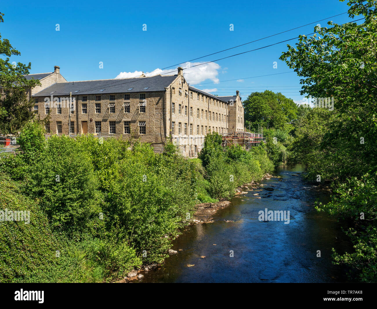 Glasshouses Mill undergoing conversion to residential use Glasshouses near Pateley Bridge North Yorkshire England - Stock Image