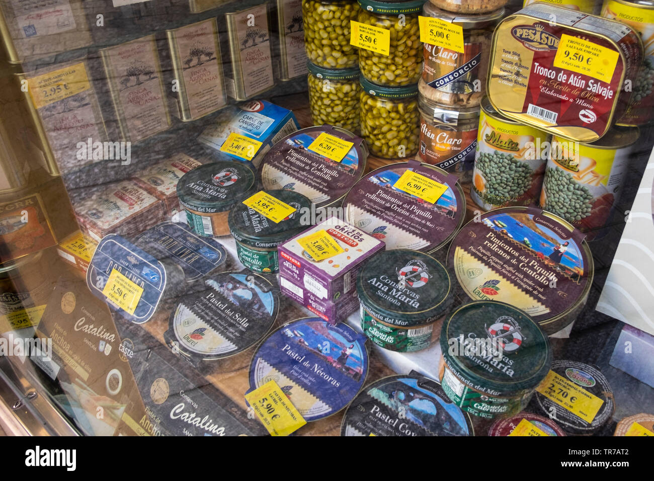 Food shop selling packaged and preserved  food in Malaga, Spain. - Stock Image