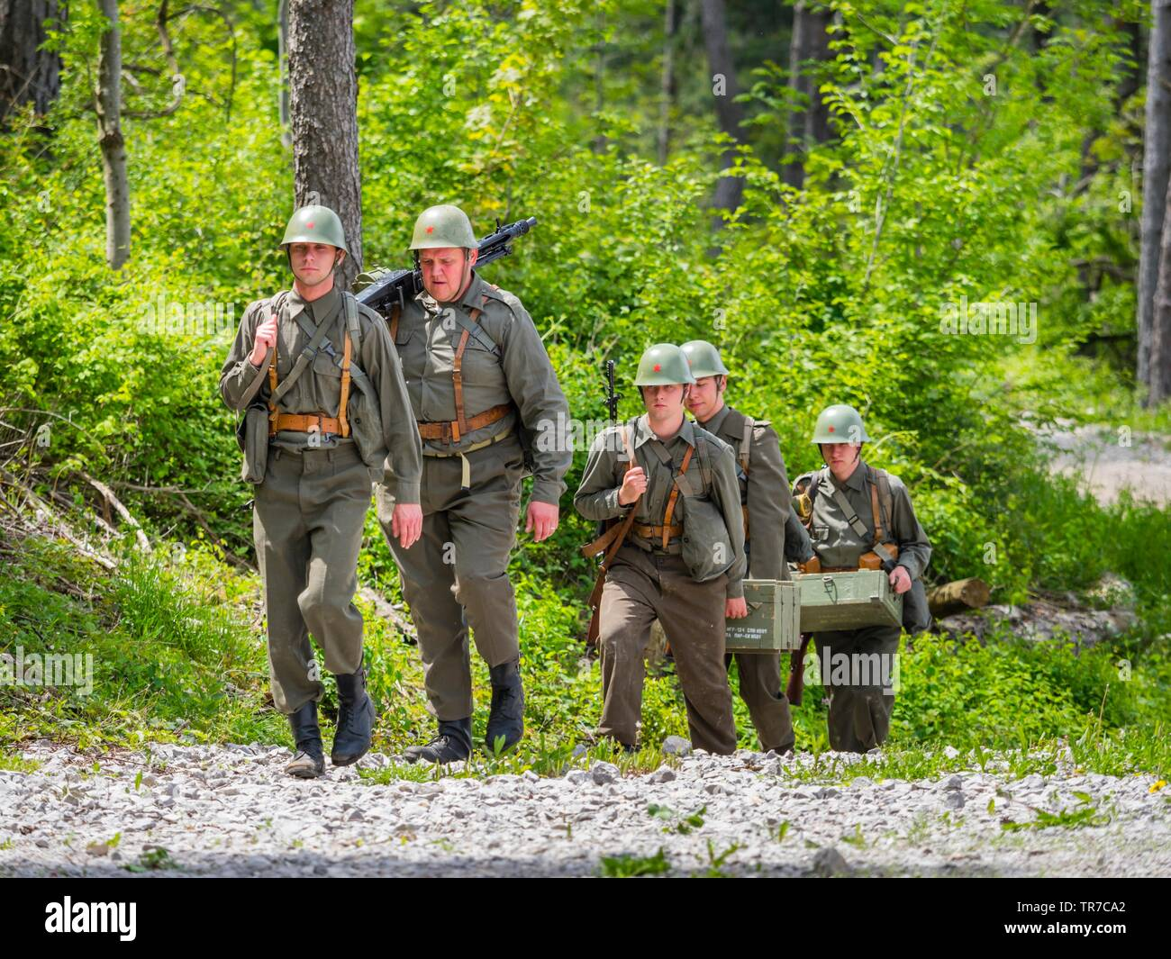 Reviving history actors of Slovenia Pivka museum of military history representing ex JNA army soldiers walking towards camera Stock Photo